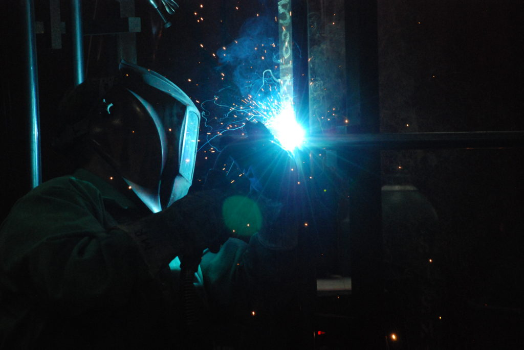 A welder finishes up a GT silencer in Arcadia WI.